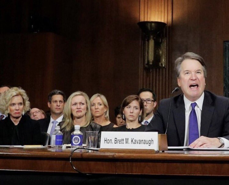 The collective looks of disapproval from the four women sitting behind Kavanaugh