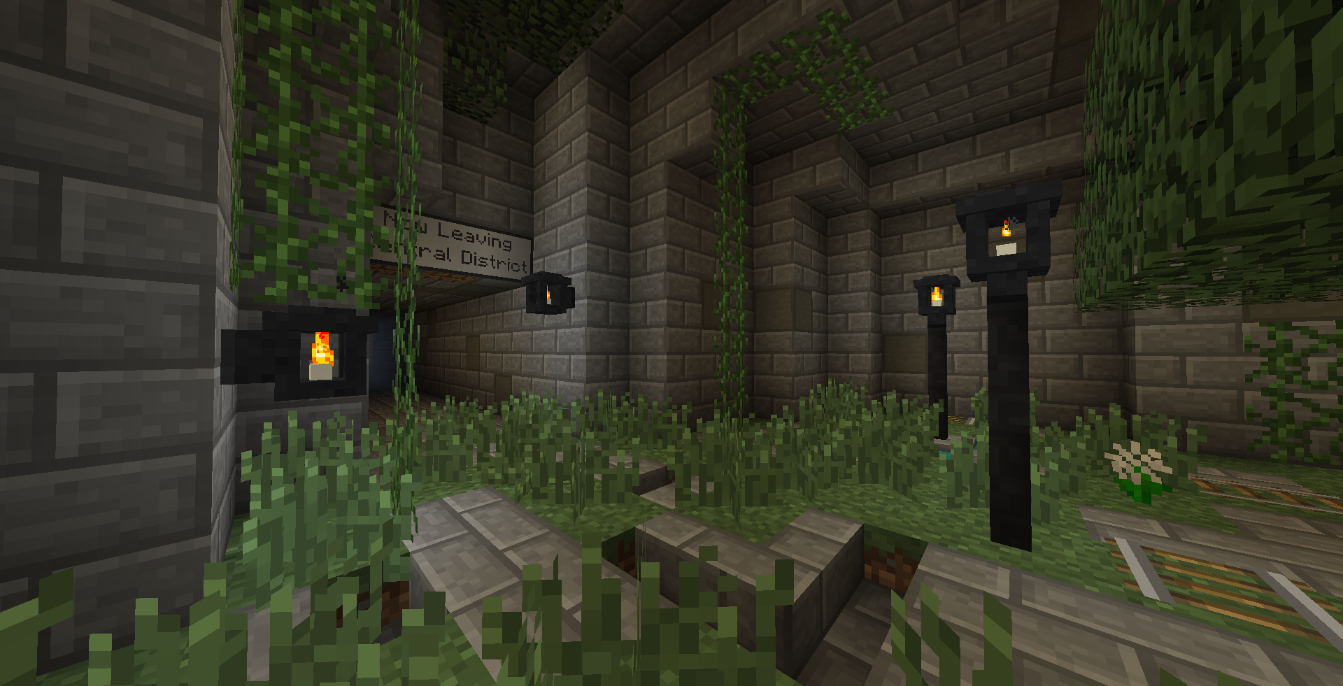 """A minecraft screenshot of an indoor brick area with street lamps overgrown with plants. There is a sign by a dark hallway which reads """"Now Leaving Central District"""""""